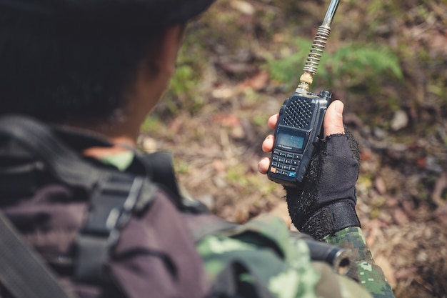 Soldier with black walky talky
