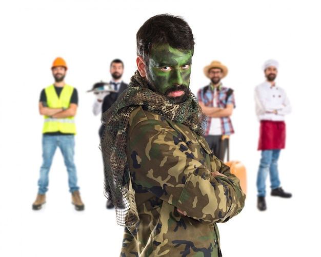 Soldier with his face painted