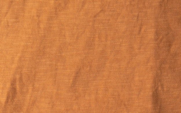 Solid seamless background of terracotta color cloth texture