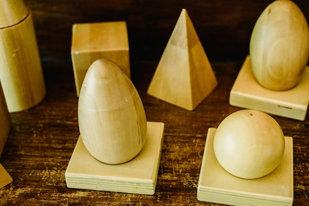 Solid wood shapes to study geometry and volumes, cones, triangles, squares, spheres