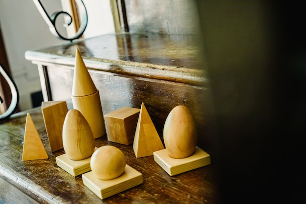 Solid wood shapes to study geometry and volumes, cones, triangles, squares