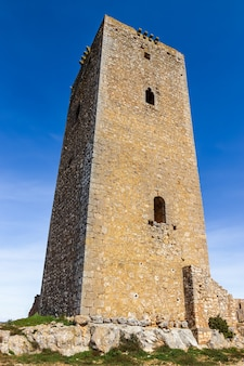 Solitary tower of medieval architecture next to the alarcãƒâ³n castle in cuenca, spain. la mancha.