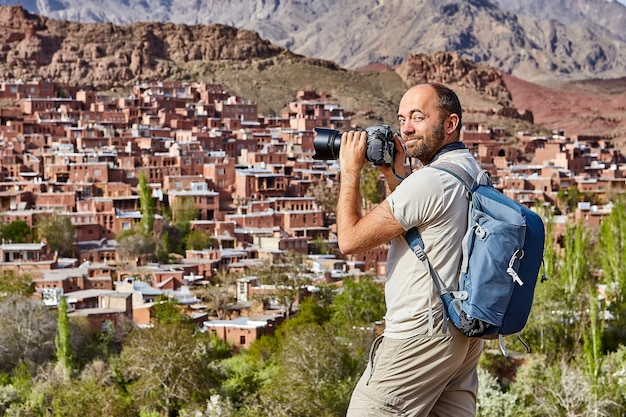Solo journey through iran, an independent tourist photographs village of abyaneh.