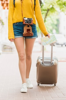 Solo traveler with her baggage