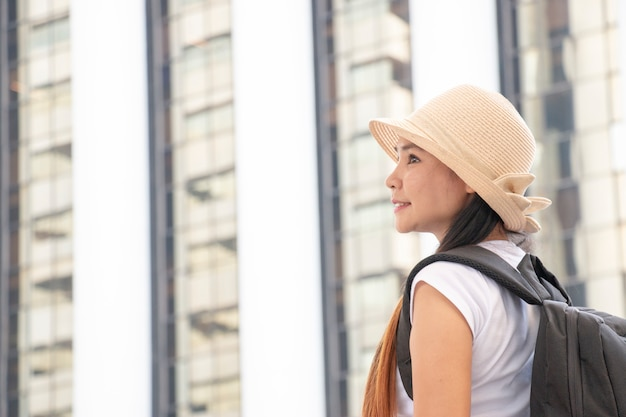 Solo woman is traveling alone in big city
