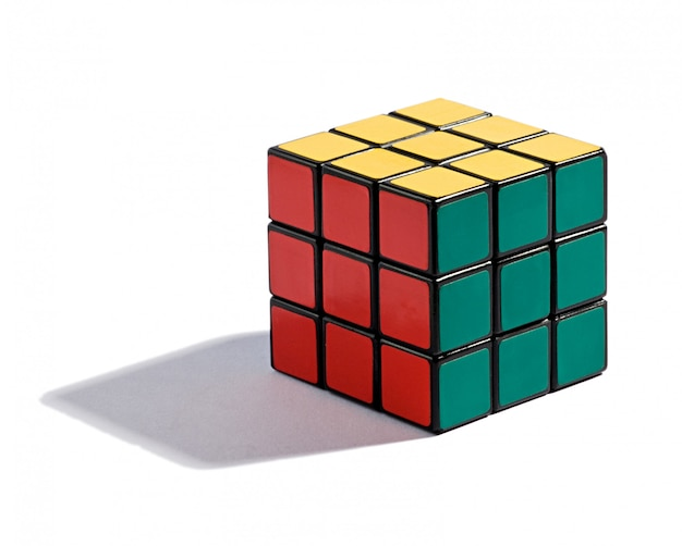 Solved rubiks cube puzzle on white