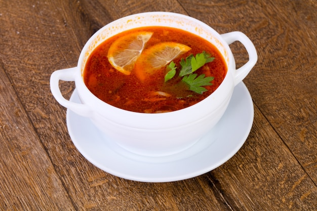 Solyanka soup with lemon