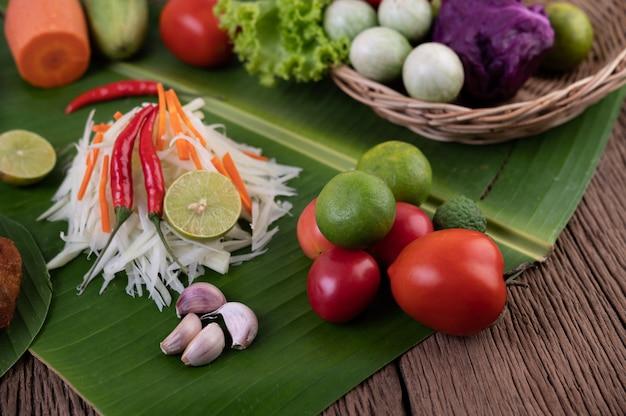 Som tam thai -ingredients papaya salad thai food style on wooden table. thai food concept.