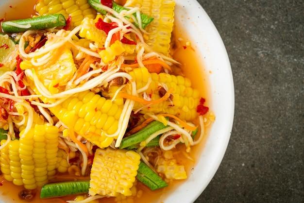 Som tum - thai spicy papaya salad with corn - asian food style