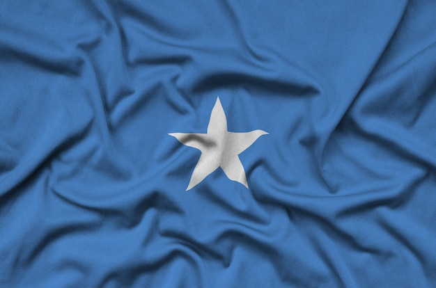 Somalia flag  is depicted on a sports cloth fabric with many folds.