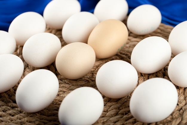 Some of brown and white raw chicken eggs .