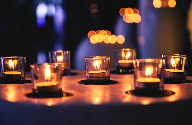 Some candles in a row in spa zone for relaxing time