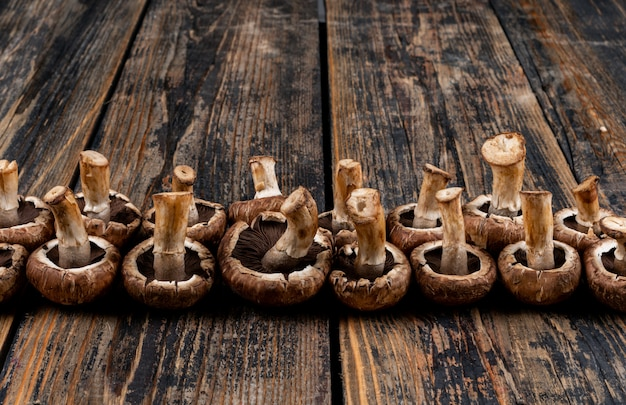 Some flipped mushrooms on dark wooden table