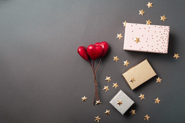 Some nice arranged decorations with hearts and stars near a free sapce
