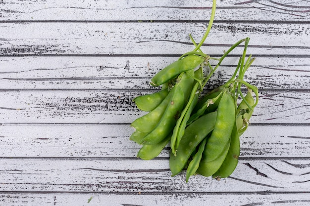 Some peas on gray wooden table