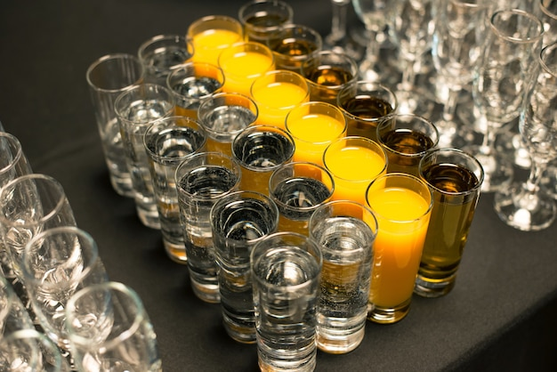 Some shots of beverages on a party table