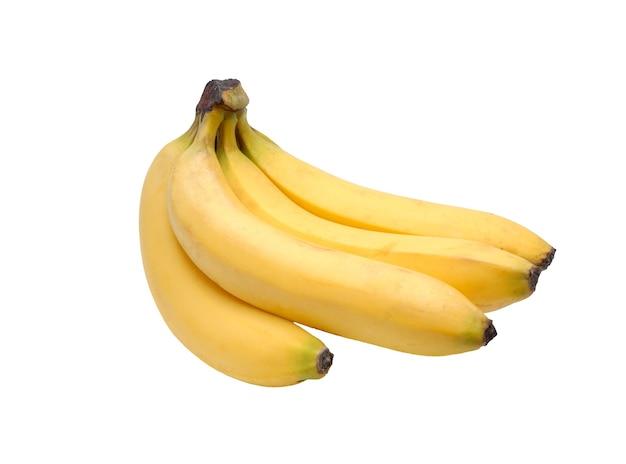 Некоторые желтые бананы на белом фоне