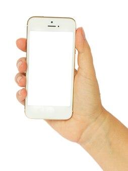 Кто-то рука держит современный белый смартфон на белом фоне с копией пространства