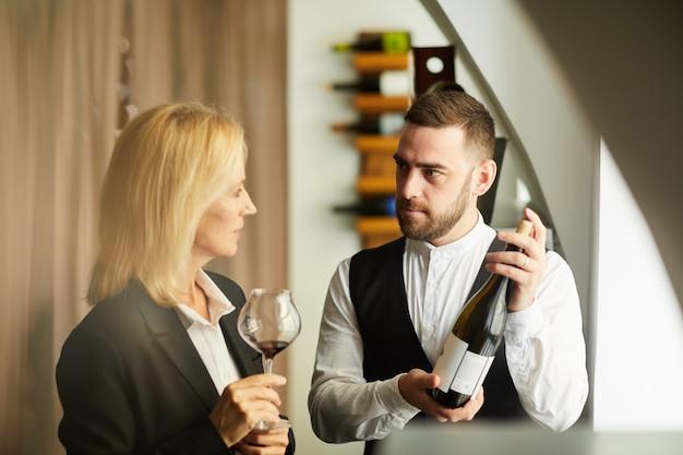 Sommelier recommending wine