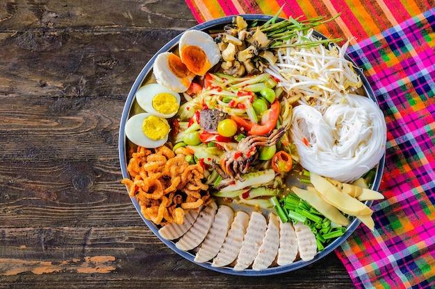 Somtam tad. papaya salad is a popular trays in thailand.