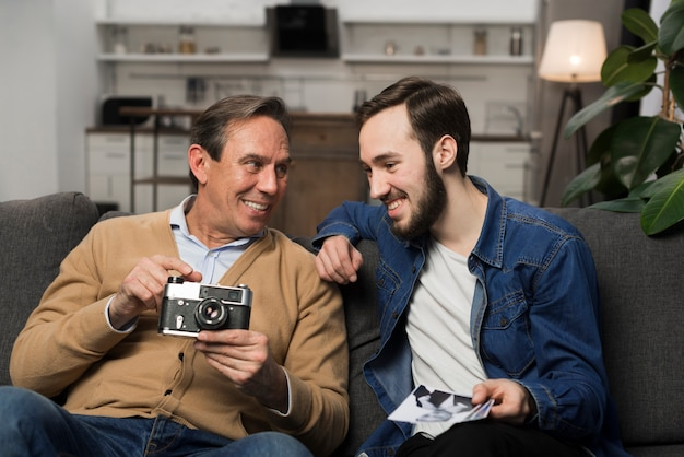 Son and father looking at pictures