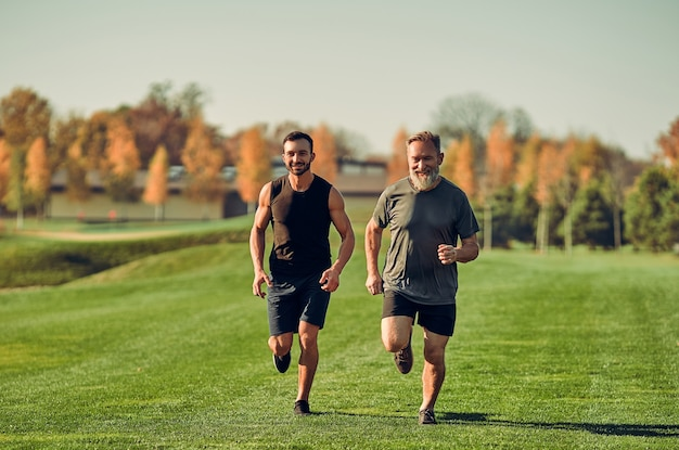 The son and father running on the grass