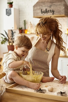 Son helps mom in the kitchen