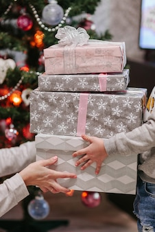 Son receiving christmas present from mom
