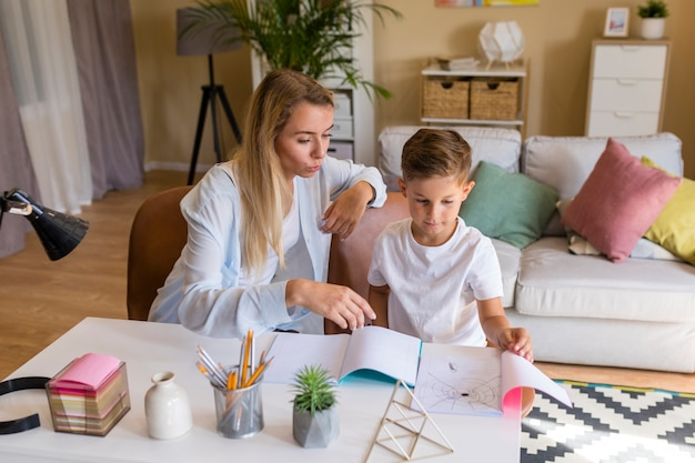 Son showing her mother a drawing
