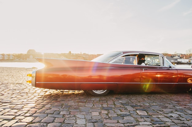 Sonderborg, denmark  american muscle car burgundy cadillac eldorado. back detail of a vintage car