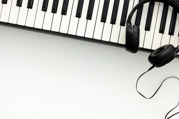 Songwriter or dj work place with synthesizer and headphones
