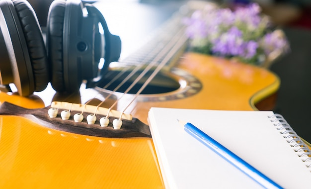 Songwriter with guitar notebook for songwriting concept