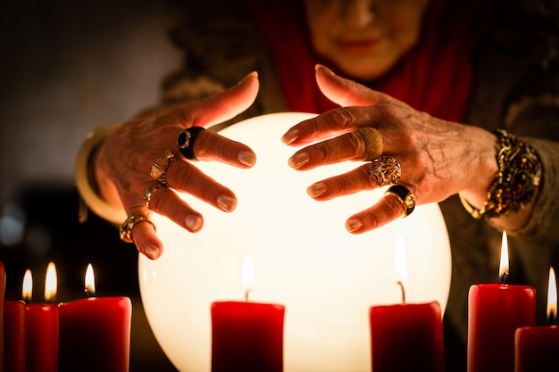 Soothsayer during a seance or session with crystal ball