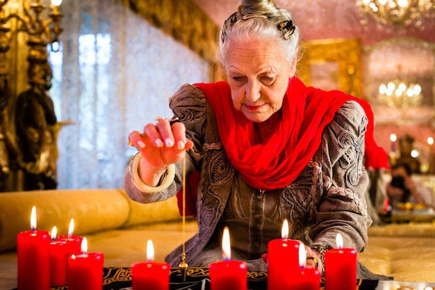 Soothsayer during a seance or session with pendulum