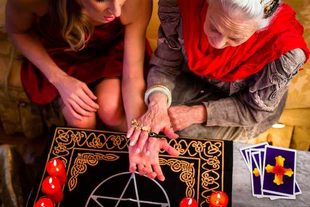 Soothsayer during a session doing palmistry