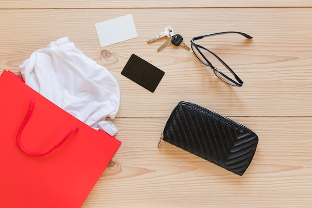 Sopping bag and woman's accessories on wooden desk