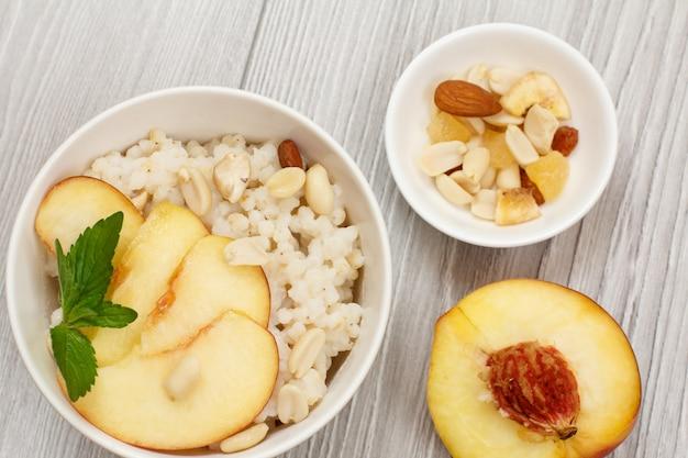 Sorghum porridge with pieces of peach
