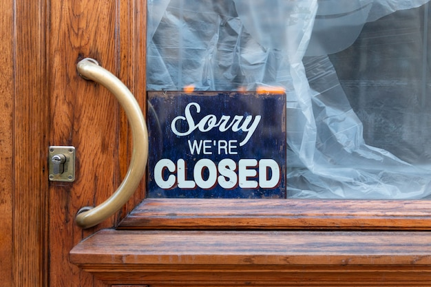Sorry, we are closed - board on cafe/restaurant, closed shut down business during coronavirus pandemic, covid-19 outbreak