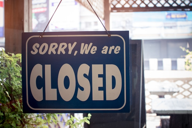 Sorry we are closed sign hanging on the door