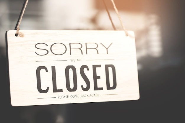 Sorry we are closed sign on shop door