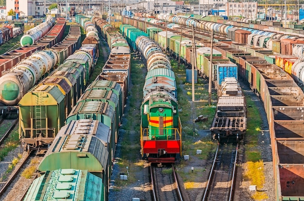 Sorting freight wagons locomotive on the railroad while formation the train.
