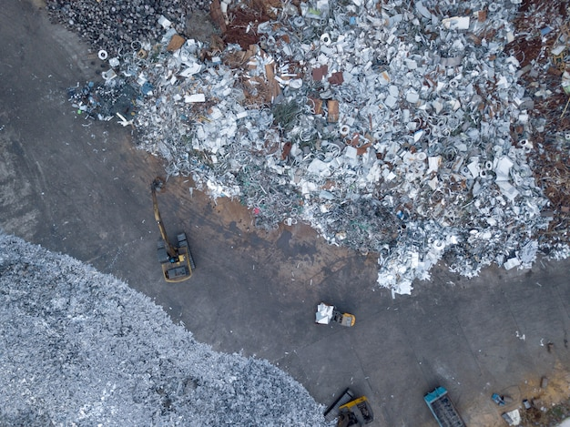 Sorting scrap metal top view aerial photography from a drone.