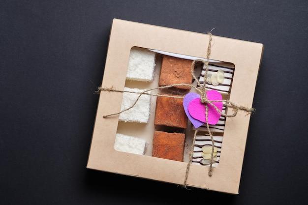 Souffle milk sweets in chocolate, coconut or cocoa. sweets are packed in a gift box. dessert bigeonãƒâƒã'âƒãƒâ'ã'â¢ãƒâƒã'â'ãƒâ'ã'â€ãƒâƒã'â'ãƒâ'ã'â™s milk as a gift.