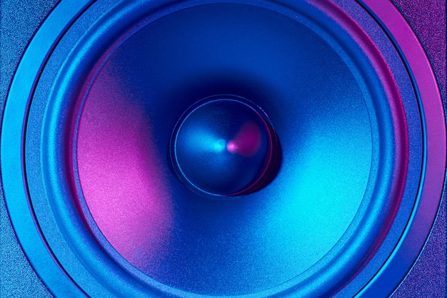 Sound audio speaker with neon lights. dynamic monitor closeup. creative backgroound