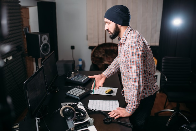 Sound engineer work with record in music studio. audio engineering