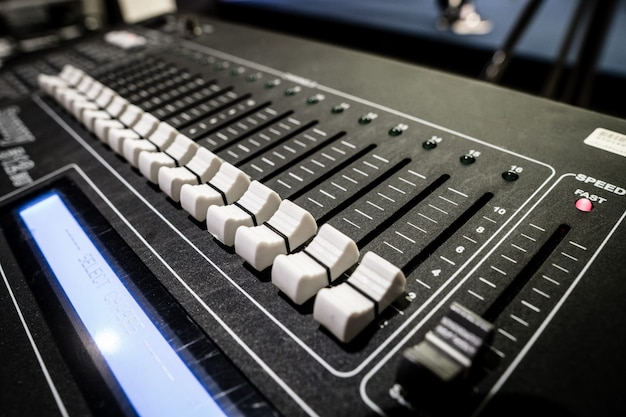 Sound mixer board with button to adjust detail