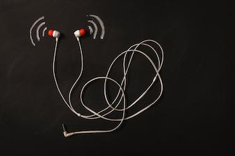 Sound wave icon near the earphone on blackboard