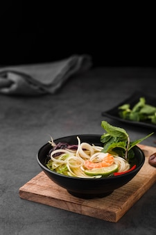 Soup bowl with noodles and mint