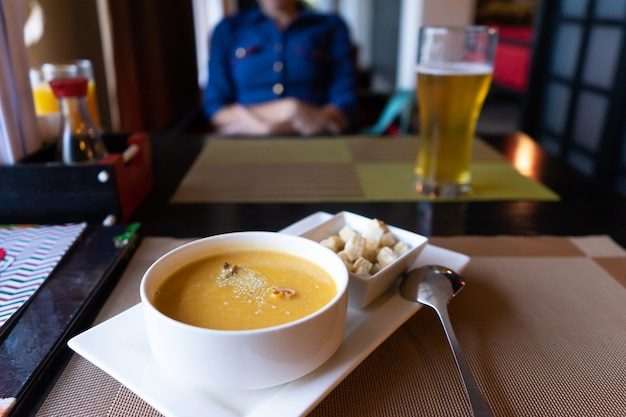 Soup puree sprinkled with sesame seeds, croutons of white bread. japanese food in the restaurant.