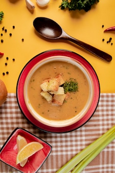 A soup topped with crackers and herbs